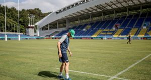 Ireland head coach Joe Schmidt checks the surface at the Hakatanomori Stadium in  Fukuoka ahead of the Rugby World Cup Pool A game against Samoa on Saturday. Photograph: Dan Sheridan/Inpho