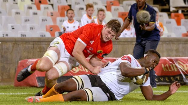 Junior Pokomela of the Cheetahs scores a try despite the efforts of Munster's Jack O'Donoghue during the Guinness Pro 14 match at the Toyota Stadium in Bloemfontein. Photograph: Frikkie Kapp/Inpho