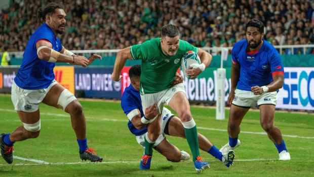 Johnny Sexton on his way to score a try during the Rugby World Cup match against Samoa in Fukuoka. Photograph: Hiroshi Yamamura/EPA