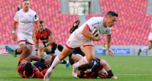 Ulster scrumhalf  John Cooney scores  one of his two tries during the Guinness Pro 14 game against the Southern Kings  at the Nelson Mandela Bay stadium in  Port Elizabeth. Photograph: Richard Huggard/Inpho