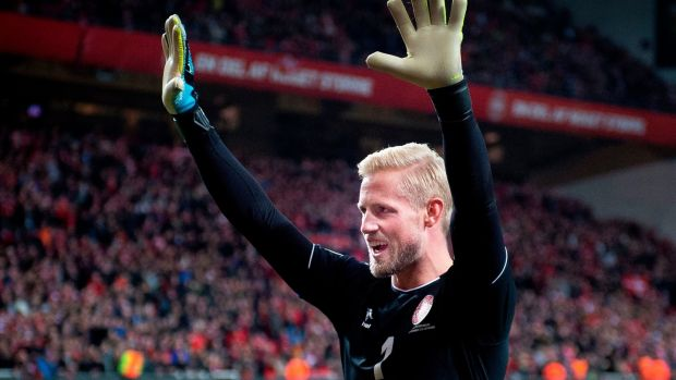 Denmark's goalkeeper Kasper Schmeichel celebrates with supporters after the match. Photograph: Liselotte Sabroe/Ritzau Scanpix/AFP via Getty Images