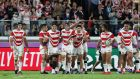 Japan players celebrate their sides third try during the Rugby World Cup quarter-final against Scotland. Photo: Craig Mercer/Getty Images