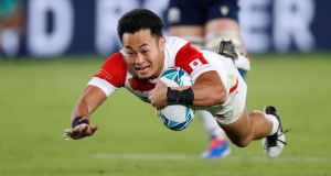 Japan's wing Kenki Fukuoka scores a try during the  Rugby World Cup Pool A match against  Scotland at the International Stadium in Yokohama. Photograph:  Odd Andersen/AFP via Getty Images