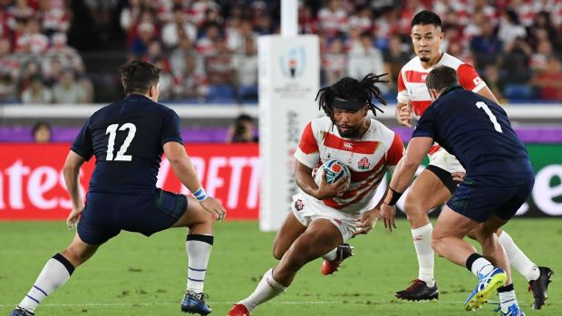 Japan hooker Shota Horie runs at Scotland's Sam Johnson and Allan Dell during the Rugby World Cup Pool A match at the International Stadium in Yokohama. Photograph: William West/AFP via Getty Images