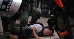 Police arresting a protester in Hong Kong.  Photograph: Mark Ralston/AFP/Getty Images