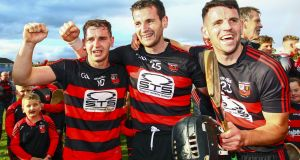 Ballygunner's Dessie Hutchinson, Wayne Hutchinson and JJ Hutchinson  celebrate the victory over De La Salle in the Waterford SHC Final at Walsh  Park. Photograph: Ken Sutton/Inpho