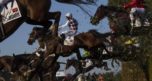 BREAK ON THROUGH: Mazhilis, a mount riden by Jan Kratochvil, jumps the taxis ditch during the Velka Pardubicka Steeplechase in Pardubice, Czech Republic. Photograph: Justin Setterfield/Getty