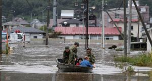 Japan self-defence forces evacuate a flooded area during search and rescue operations in the aftermath of Typhoon Hagibis in Marumori, Miyagi. Photograph: Jiji Press/AFP/Getty Images.