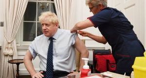 UK prime minister Boris Johnson has a flu jab in Downing Street on Monday morning before the state opening of parliament.  Photograph: Jeremy Selwyn/PA