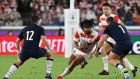 Japan's hooker Shota Horie and fly-half Yu Tamura with Scotland's centre Sam Johnson  and prop Allan Dell during their Rugby World Cup Pool A match in Yokohama on Sunday. Photograph:  William West/AFP via Getty Images