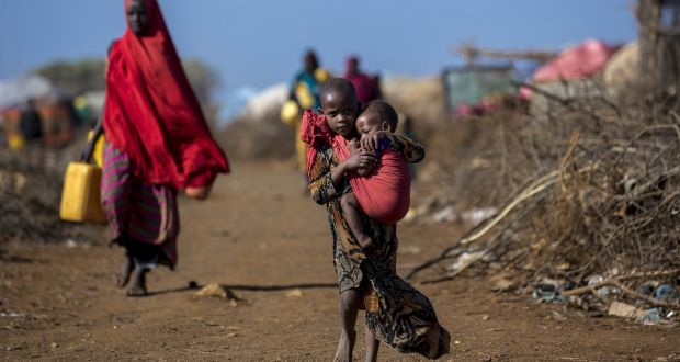 A Somalian girl carries her sibling at the Mooro Hagar camp in  Somalia's Bay state, an area that has been subject to extreme drought. Photograph: Arif Hudaverdi Yaman/Anadolu Agency/Getty Images