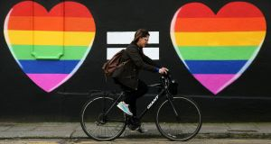 A file image of woman cycling  past a marriage equality mural in the Liberties area of Dublin. Ireland became the first country in the world to approve same-sex marriage by popular vote in May 2015, with 62 per cent voting to pass the referendum. Photograph: Brian Lawless/PA Wire.