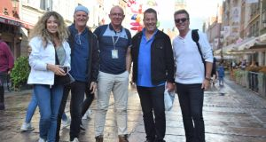 Michael Gannon (centre) in Gdansk this summer with Canadian rock group 'Glass Tiger' who  had a hit  with The Chieftains in the 1980s. He was their tour guide for the day.