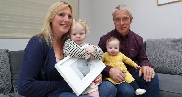 Anne-Marie Murtagh, holding a photograph of her son Patrick, who was stillborn, with daughters Hope and Grace and husband Paul Flood. Photograph: Nick Bradshaw