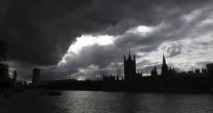 Clouds gather over the Houses of Parliament in London, U.K., on Tuesday, Oct. 15, 2019. U.K. Prime Minister Boris Johnson's hopes of a Brexit deal are likely to depend on him not only persuading the European Union to compromise, but his Northern Irish allies too. Photographer: Simon Dawson/Bloomberg