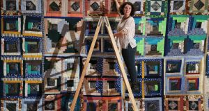 HOW TO MAKE AN IRISH QUILT: Zoe-Mae Stevens from Co Tipperary with her installation 'Irish landfill quilt' at the RDS Visual Art Awards. Photograph: Nick Bradshaw