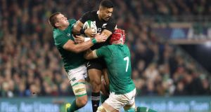 Ireland's CJ Stander and Josh van der Flier tackle New Zealand's Richie Mo'unga at the Aviva Stadium last November. Ireland must  deny the All Blacks possession and momentum. Photograph: billy Stickland/Inpho