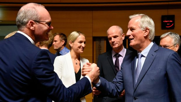 Tánaiste Simon Coveney shakes hands with the European Union's chief Brexit negotiator Michel Barnier in Luxembourg. Photograph: John Thys/AFP via Getty Images