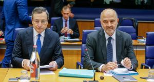 European Central Bank (ECB) President Mario Draghi (L) and Pierre Moscovici, the European Commissioner for Economic and Financial Affairs and Taxation (R) at the start of the Eurogroup meeting in Luxembourg. Photograph: Julien Warnand/EPA