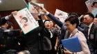 Hong Kong leader Carrie Lam abandons speech over heckling