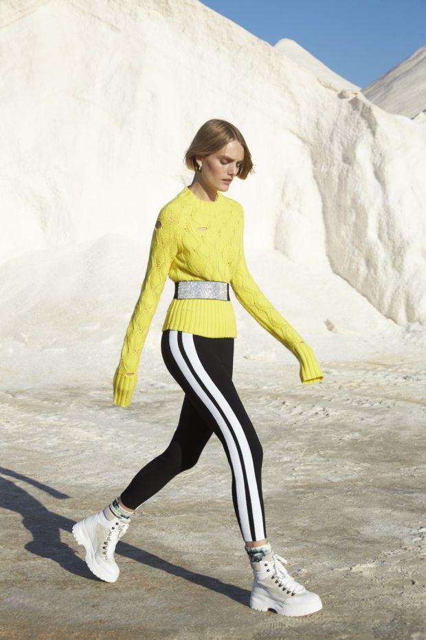 Zoe Jordan's silve leggings (€195) and yellow Parker knit (€280)