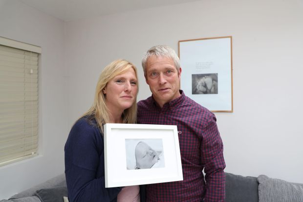 Anne Marie Murtagh and Paul Flood with a picture of Patrick.