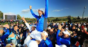 Europe captain Catriona Matthew is hoisted up by her players to celebrate her team's win over the United States in te Solheim Cup  at Gleneagles in September. Photograph:  David Cannon/Getty Images