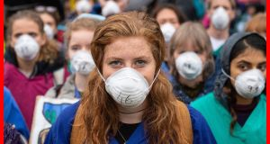 Doctors who gathered earlier this week to protest in support of Extinction Rebellion  in  London to highlight deaths caused by air pollution.  Photograph: Dominic Lipinski/PA Wire