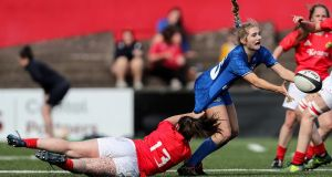 Leinster's Anna Doyle is tackled by Munster's Ciara Scanlon during the women's Interprovincial at  Irish Independent Park, Cork. Photograph: Laszlo Geczo