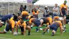 South Africa players stretch during a training session in Tokyo ahead of the Rugby World Cup quarter-final against Japan. Photo: Mark Baker