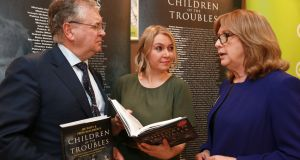 Joe Duffy and Freya McClements, authors of Children of the Troubles, with former president Mary McAleese at the launch of the book at Eason in Dublin. Photograph: Laura Hutton