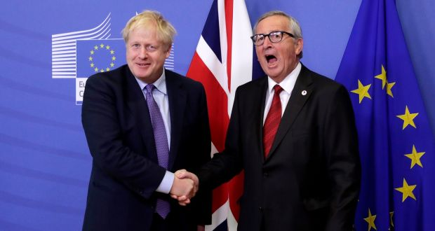President of the European Commission Jean-Claude Juncker and British prime minister Boris Johnson shake hands in Brussels on Thursday. Photograph: Olivier Hoslet/EPA