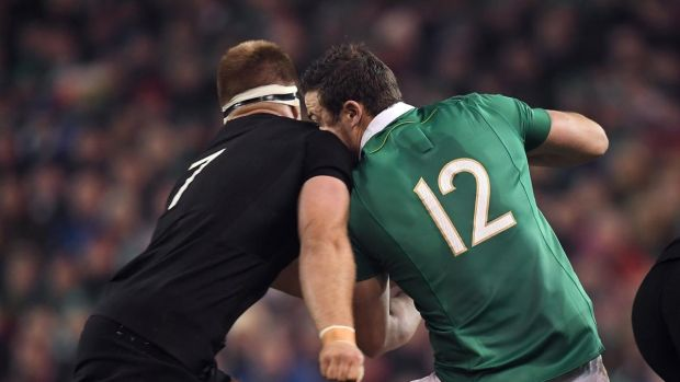 Robbie Henshaw of Ireland is tackled by Sam Cane in the return match in Dublin.