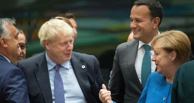 Boris Johnson, Leo Varadkar and Angela Merkel: smiling today,  but what about tomorrow? Photograph: PA Wire