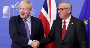 President of the European Comission Jean-Claude Juncker, right, and UK prime minister Boris Johnson shake hands during a press conference on the Brexit deal in Brussels on October 17th. Photograph: EPA/OLIVIER HOSLET