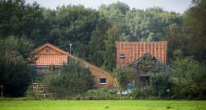 A farmhouse near the village of Ruinerwold in the Netherlands where polkice this week found a 58-year-old man and a group of young adults between 18 and 25 who had been living for years without contact with the outside world. Photograph: Vincent Jannink/EPA