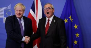European Commission president Jean-Claude Juncker and British prime minister Boris Johnson shake hands during a press conference on the Brexit deal in Brussels on Thursday. Photograph: Olivier Hoslet/EPA