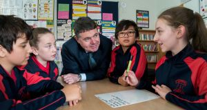 Minister for Finance & Public Expenditure Paschal Donohoe at a special budget briefing for Maths Week with Paul Giurgi, Ellie Smith, Patrick Miaskowski, and Sasha Butala from 6th class, St Peter's National School, Phibsborough, Dublin. Photograph: John Ohle Photography
