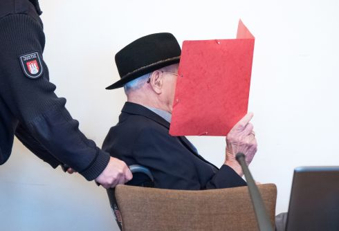 FACING THE MUSIC: Defendant Bruno D arrives in the court room of the Higher Regional Court of Hamburg, Germany. The 93-year-old is accused of having served as a guardsman at the concentration camp Stutthof near Danzig in 1944 and 1945, abetting murder of more than 5,000 inmates of the camp. Photograph: Daniel Bockwoldt/EPA