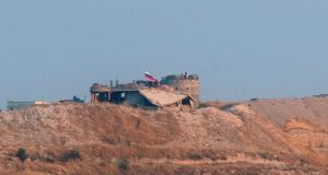 A picture taken from Turkish territory shows a Russian flag and a Syrian flag waving on a hill near the Zor Magar village of Syria. Photograph: Erdem Sahin/EPA