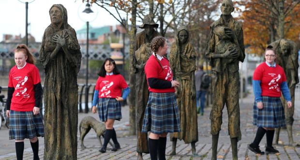 Young girls from Mount Carmel Girls Secondary School at the Famine Memorial statues on Custom House Quay, Dublin, Photograph: Laura Hutton/The Irish Times