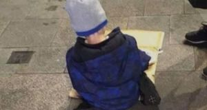 The photo of Sam (5) shown eating his dinner from a sheet of cardboard on a Dublin street this week. Image: The Homeless Street Cafe/Facebook