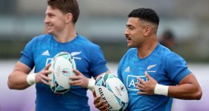 Beauden Barrett and Richie Mo'unga of the All Blacks run through drills during a  training session at Tatsuminomori Seaside Park  in Tokyo. Photograph: Hannah Peters/Getty Images