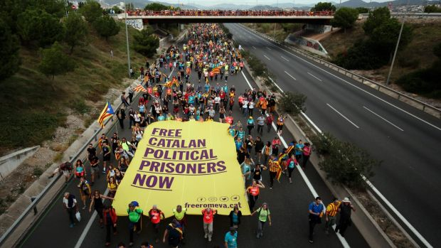 Pro-independence protesters march in Barcelona. Photograph: Pau Barrena/AFP