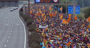 Pro independence protesters march along a highway near Barcelona om Friday morning. Photograph: Pau Barrena/AFP