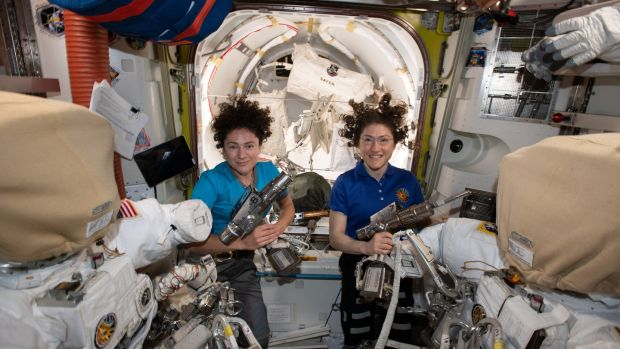 NASA astronauts Jessica Meir (L) and Christina Koch inside the Quest airlock preparing the US spacesuits and tools they will use on their first spacewalk together. Photograph: EPA/NASA HANDOUT /JOHNSON SPACE CENTER