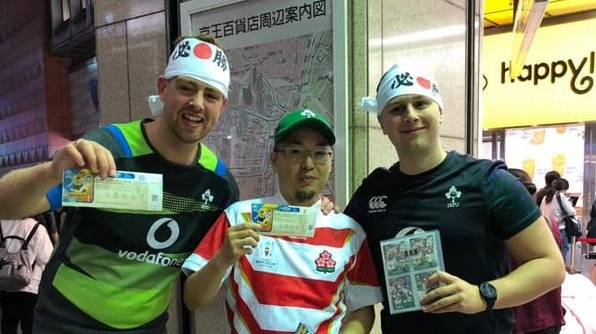 Irish and Japanese rugby fans swap tickets. Photograph via the Irish Rugby World Cup Japan Forum Facebook page
