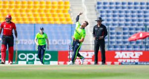 Ireland's Mark Adair bowling during the T20 World Cup qualifier against Hong Kong at the Sheikh Zayed stadium in Abu Dhabi. Photograph: ICC