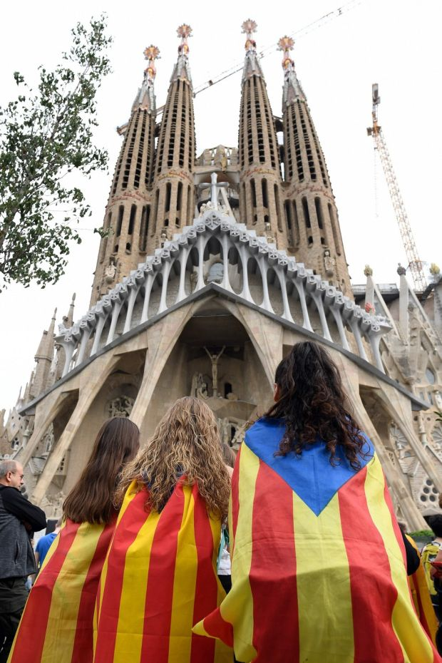 Pro-independence protesters gather in front of the Sagrada Familia basilica in Barcelona. Photograph: Josep Lago / AFP