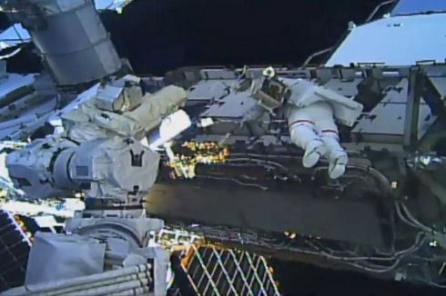 SPACEWALK: NASA astronauts Christina Koch and Jessica Meir working to replace a broken power control unit, called battery charge-discharge unit on the International Space Station on Friday. It is the first all-female spacewalk and lasted about five hours. Photograph: EPA/NASA TV handout